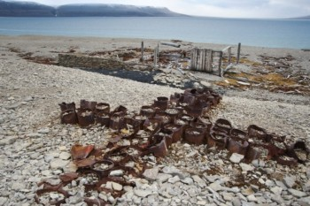 Memorial cross of empty tin cans,<br />used as a post office to leave messages,<br />dates to 1854 and the search for survivors<br />of the ill-fated Sir John Franklin Expedition.<br />It's located on Beechey Island in Nunavut, Canada<br />(© Pat and Rosemarie Keough/Corbis)